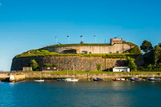 Nothe Fort, brick fort on hill harbour below sunny day