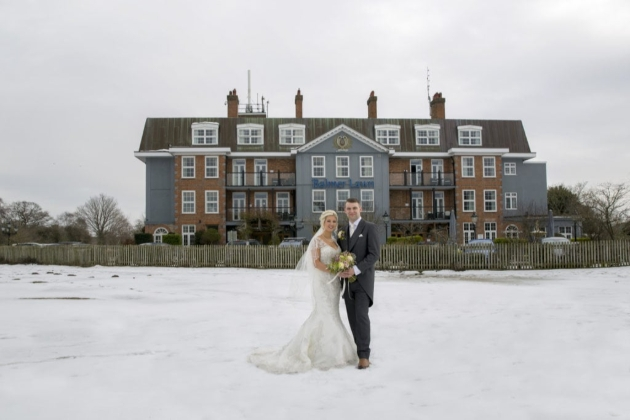 Balmer Lawn Hotel & Spa, front of hotel, snow on lawn with couple standing in it