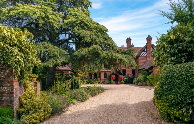 Careys Manor Hotel & SenSpa, red house surrounded by gardens