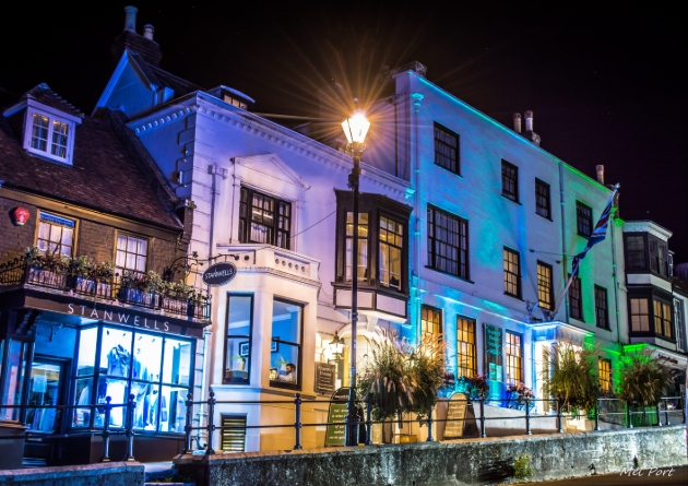 Stanwell House Hotel, white facade hotel on highstreet at night