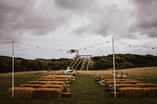 al fresco wedding set up haybales and chairs cloudy day