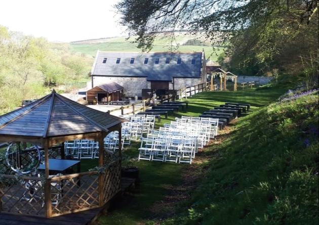 Gorwell Farm al fresco wedding set up under pagoda farm building in background