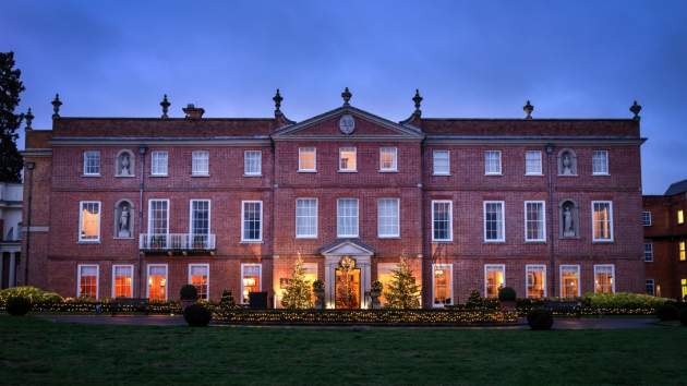Four Seasons Hotel, red brick house, lit up at night by floodlights