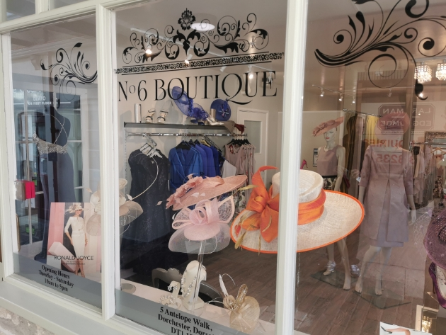 shop window filled with mother of the bride clothes