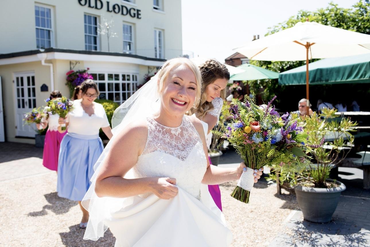 Bride smiles with bridesmaids